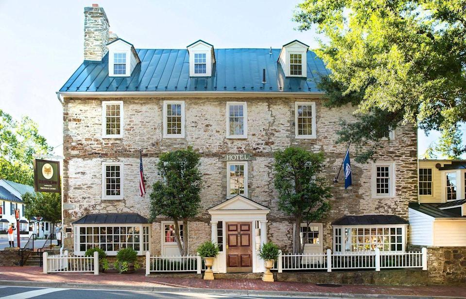 """<p>The beautiful worn exterior, historical paintings, and bar made from an old surgeon's table immediately evoke the history behind this <a href=""""https://www.tripadvisor.com/Restaurant_Review-g57963-d1024082-Reviews-The_Red_Fox_Inn_Tavern-Middleburg_Loudoun_County_Virginia.html"""" rel=""""nofollow noopener"""" target=""""_blank"""" data-ylk=""""slk:Middleburg landmark"""" class=""""link rapid-noclick-resp"""">Middleburg landmark</a>. The old fox hunting grounds offer a romantic setting to dine on classic Virginia peanut soup and other high-end offerings.</p>"""