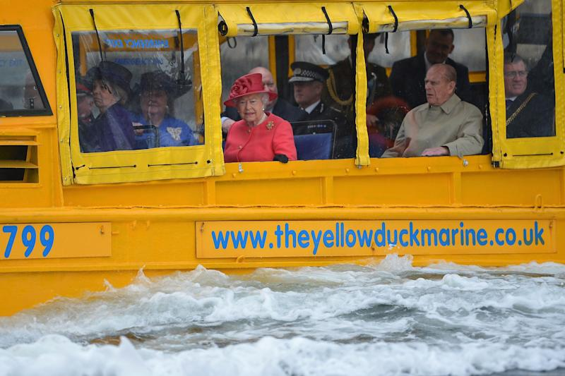 Queen Elizabeth II and Prince Philip, Duke of Edinburgh take a ride on the Yellow Duck and amphibious vehicle during a visit to Merseyside Maritime Museum on May 17, 2012 in Liverpool, England.