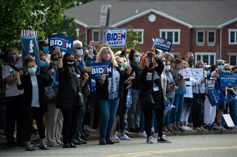 Supporters of Democratic presidential nominee Joe Biden cheered outside the Greensburg Train Station in Greensburg, Pennsylvania as Biden made a stop there on a train tour across battleground states Ohio and Pennsylvania
