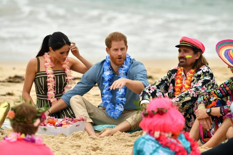 Britain's Prince Harry and his wife Meghan, Duchess of Sussex talk to members of OneWave, an awareness group for mental health and wellbeing at Sydney's Bondi Beach