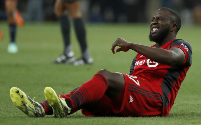 Toronto FC's Jozy Altidore grimaces in pain during the CONCACAF Champions League final soccer match against Chivas, in Guadalajara, Mexico, Wednesday, April, 25, 2018. (AP Photo/Eduardo Verdugo)