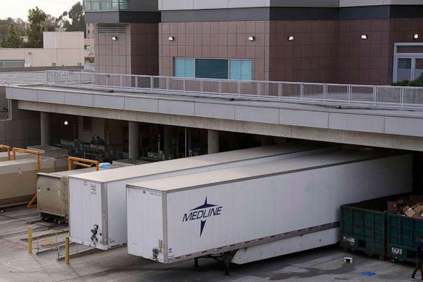 PHOTO: Temporary refrigerator containers are parked at the Los Angeles County-USC Medical Center hospital amid COVID-19 pandemic, Jan 7, 2020, in Los Angeles. (Kirby Lee/AP)
