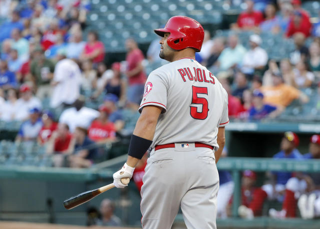 Los Angeles Angels' Albert Pujols watches his three-run home run ball off a pitch from Texas Rangers' Kolby Allard in the first inning of baseball game in Arlington, Texas, Monday, Aug. 19, 2019. (AP Photo/Tony Gutierrez)