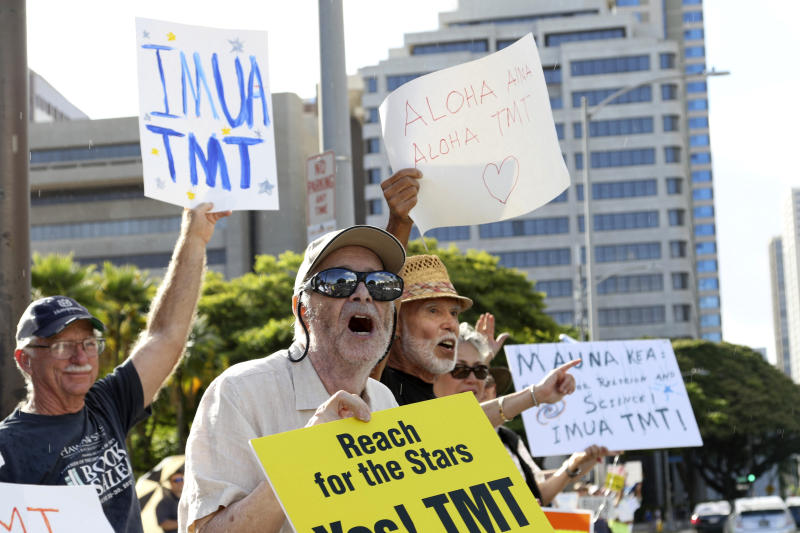 Supporters of the Thirty Meter Telescope, gather for a rally outside the Hawaii State Capitol in Honolulu on Thursday, July 25, 2019. Supporters said the giant telescope planned for Hawaii's tallest mountain will enhance humanity's knowledge of the universe and bring quality, high-paying jobs, as protesters blocked construction for a second week. (AP Photo/Audrey McAvoy)