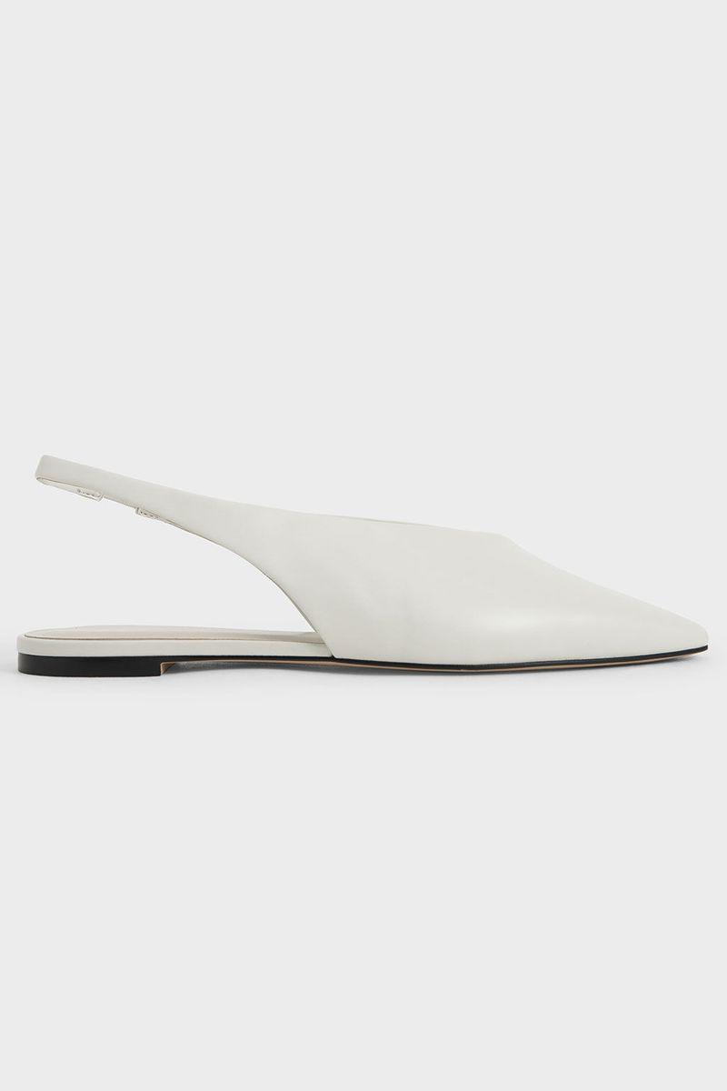 """<p><strong>Charles & Keith</strong></p><p>charleskeith.com</p><p><strong>$46.00</strong></p><p><a href=""""https://go.redirectingat.com?id=74968X1596630&url=https%3A%2F%2Fwww.charleskeith.com%2Fus%2Fshoes%2FCK1-70380830_WHITE.html&sref=https%3A%2F%2Fwww.marieclaire.com%2Ffashion%2Fg35614014%2Fpointed-toe-ballet-flats%2F"""" rel=""""nofollow noopener"""" target=""""_blank"""" data-ylk=""""slk:SHOP IT"""" class=""""link rapid-noclick-resp"""">SHOP IT</a></p><p>Pair this with a white or pastel sundress for a breezy look. </p>"""