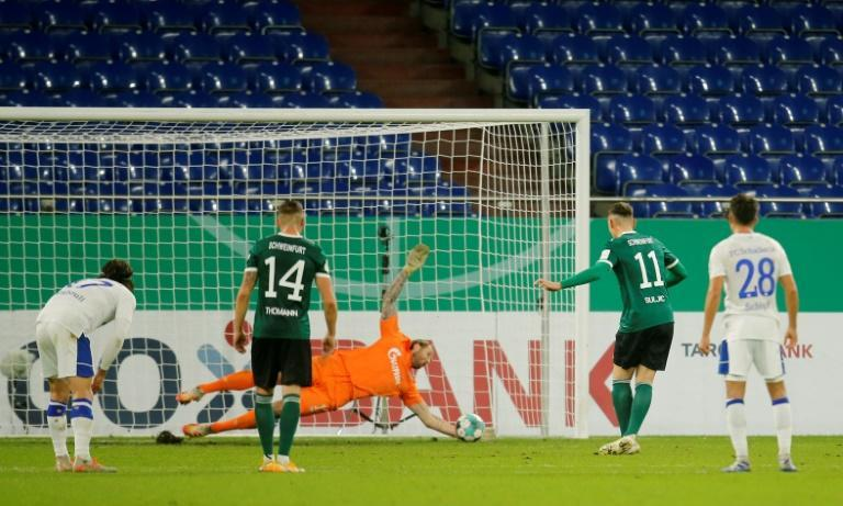 Schalke goalkeeper Ralf Fahrmann (C) saves a penalty from Schweinfurt's Amar Suljic (2ndR) in the home side's 4-1 German Cup victory over Schweinfurt
