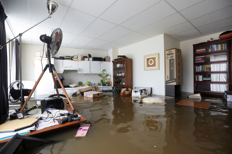 FILE PHOTO: A view shows flooded interior of a house in Guelle