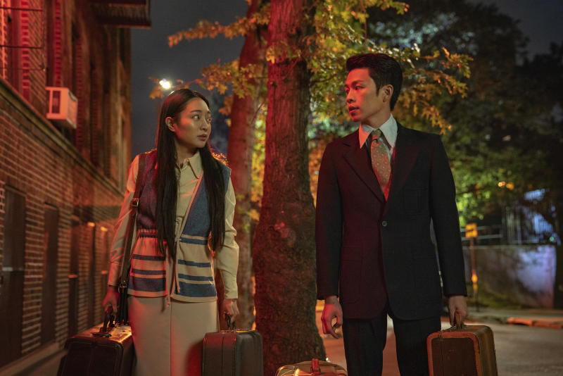 """In this image released by Netflix, Kunjue Li , left, and Hong Chi appear in a scene from """"Tigerail."""" (Sarah Shatz/Netflix via AP)"""