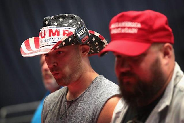 Supporters shop for campaign merchandise before the start of a President Trump's rally in Iowa on June 21. (Photo: Scott Olson/Getty Images)