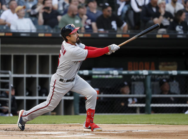 Washington Nationals' Anthony Rendon watches his two-run home run off Chicago White Sox starting pitcher Manny Banuelos during the first inning of a baseball game Tuesday, June 11, 2019, in Chicago. (AP Photo/Charles Rex Arbogast)
