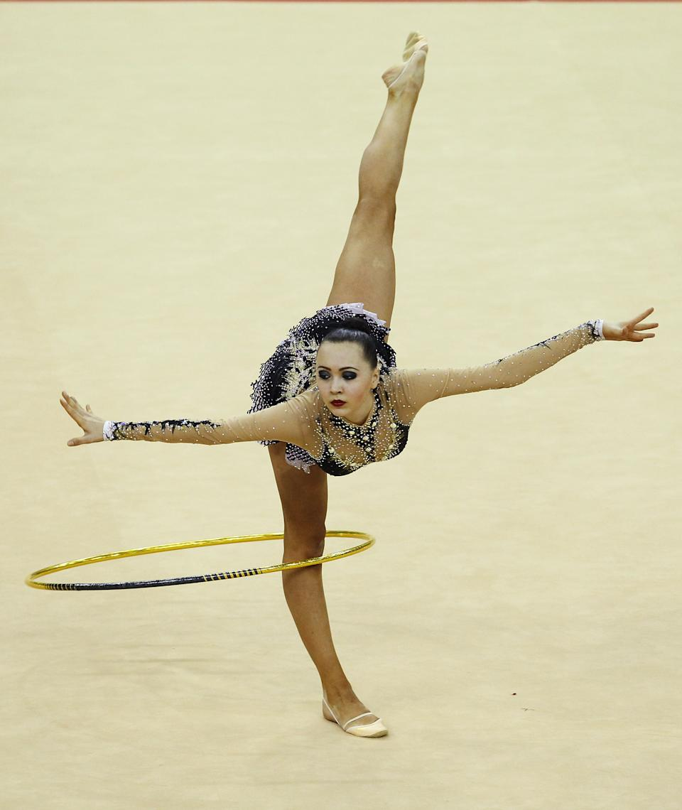 LONDON, ENGLAND - JANUARY 16: Anna Alyabyeva of Kazakhstan in action in the Individual All-Around during the FIG Rhythmic Gymnastics Olympic Qualification round at North Greenwich Arena on January 16, 2012 in London, England. (Photo by Ian Walton/Getty Images)