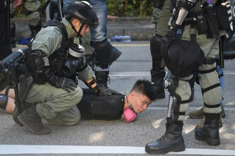 Police detain a demonstrator during protests in Hong Kong's Tuen Mun district (AFP Photo/Nicolas ASFOURI)