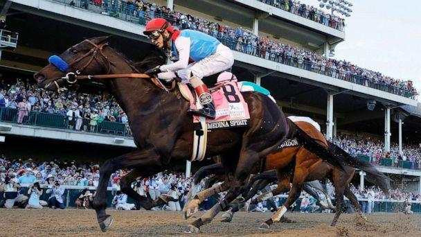 PHOTO: Medina Spirit #8, ridden by jockey John Velazquez, (R) crosses the finish line to win the 147th running of the Kentucky Derby at Churchill Downs, May 1, 2021, in Louisville, Kentucky. (Tim Nwachukwu/Getty Images, FILE)