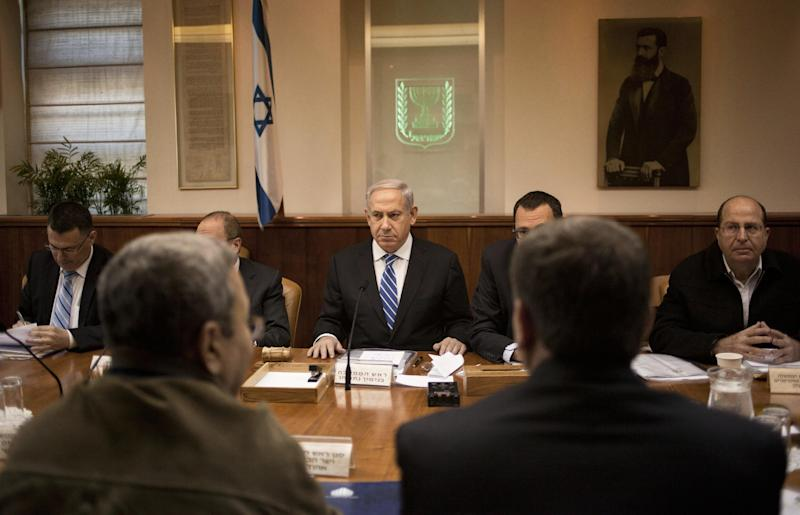 Israeli Prime Minister Benjamin Netanyahu, center, attends the weekly cabinet meeting in his Jerusalem office, Sunday, March 10, 2013. (AP Photo/Sebastian Scheiner, Pool)