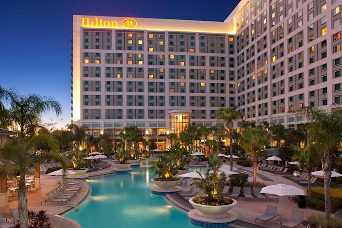 Exterior and pool view in the evening of Hilton Orlando