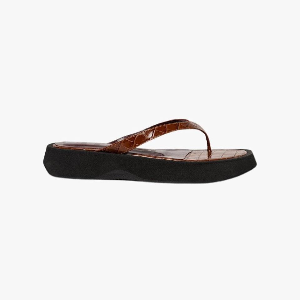 """$295, STAUD. <a href=""""https://staud.clothing/collections/shoes/products/tessa-sandal-saddle-croc-embossed-black?variant=38086087835821"""" rel=""""nofollow noopener"""" target=""""_blank"""" data-ylk=""""slk:Get it now!"""" class=""""link rapid-noclick-resp"""">Get it now!</a>"""