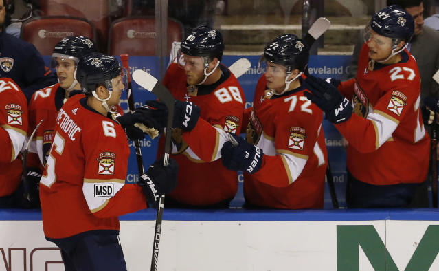 Florida Panthers defenseman Alexander Petrovic (6) celebrates his game-winning goal against the Carolina Hurricanes with teammates during an NHL hockey game, Monday, April 2, 2018, in Sunrise, Fla. The Panthers won the game 3-2. (AP Photo/Joe Skipper)