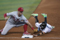 Philadelphia Phillies first baseman Rhys Hoskins, left, picks off Miami Marlins' Miguel Rojas as he dives back to first base during the eighth inning of a baseball game, Thursday, May 27, 2021, in Miami. (AP Photo/Wilfredo Lee)
