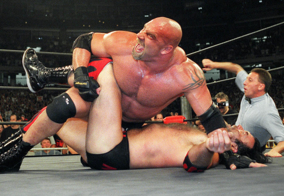 FILE - In this July 6, 1998, file photo, wrestling heavyweight champion Bill Goldberg puts Scott Hall to the mat during a match in Atlanta. Goldberg was seemingly retired, dabbling in acting, and far removed from the days of his reign as undefeated champion in WCW or WrestleMania winner for WWE. The 54-year-old Goldberg returns for his second match of the year when he challenges Bobby Lashley for the WWE title Saturday night, Aug. 21, 2021, at SummerSlam at Allegiant Stadium. (AP Photo/Erik S. Lesser, File)
