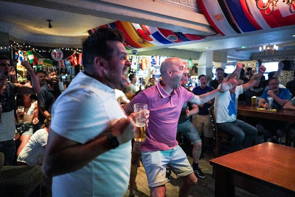 <p>Fans celebrated at the Royal Pavilion Tavern in Brighton as England shot their way to victory. (Picture: Getty) </p>
