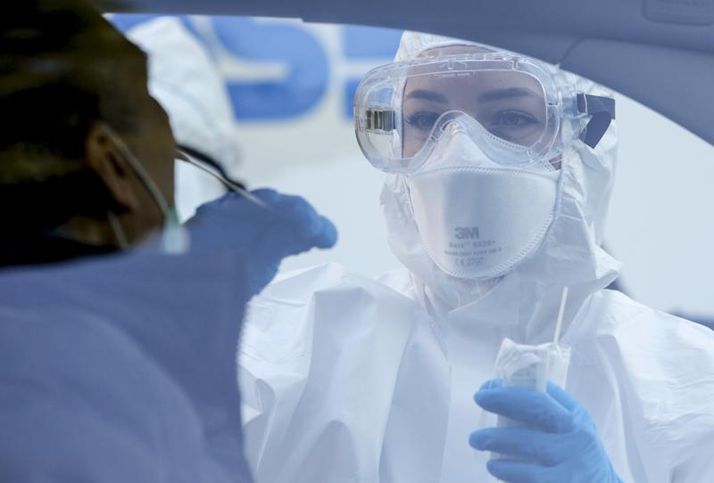ROME, ITALY - APRIL 08: A medical worker wearing protective equipment and mask collects a mouth and nose swab from a person sitting inside a car during a drive-thru coronavirus (Covid-19) test at the the ASL Roma 1's Santa Maria della Pieta' health center in Rome, Italy, on April 08, 2020. WHO Europe's director Hans Henri P. Kluge said it is still too early to undo coronavirus lockdowns. (Photo by Riccardo De Luca/Anadolu Agency via Getty Images)