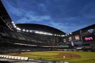 The Colorado Rockies and the Arizona Diamondbacks compete during the first inning of a baseball game, Wednesday, Aug. 26, 2020, in Phoenix. (AP Photo/Matt York)
