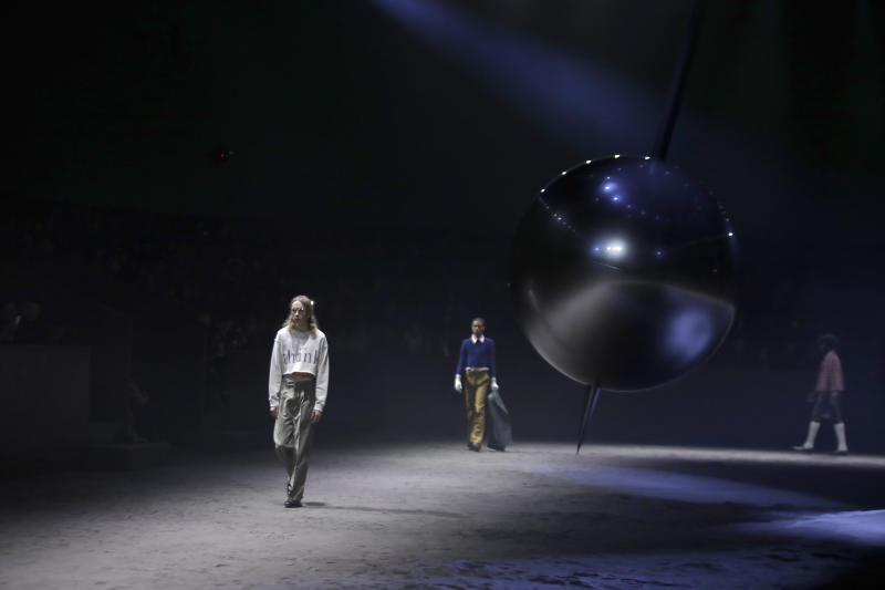 Models wear creations as part of the Gucci men's Fall-Winter 2020/21 collection, that was presented in Milan, Italy, Tuesday, Jan. 14, 2020. (AP Photo/Luca Bruno)