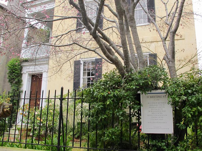 A home in the historic district in Charleston, S.C., is seen in this March 11, 2013 photograph. While visitors can take tours with paid guides or purchase various guidebooks, many historic homes in the city have signs explaining a bit of their history. (AP Photo/Bruce Smith)