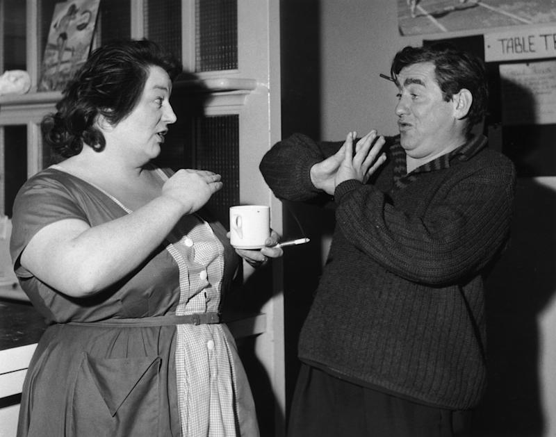 English actor and comedian Tony Hancock (1924 - 1968) shares a joke with actress Hattie Jacques (1922 - 1980) during a break from the 'Hancock's Half Hour' rehearsals, 21st October 1959. (Photo by John Pratt/Keystone Features/Hulton Archive/Getty Images)