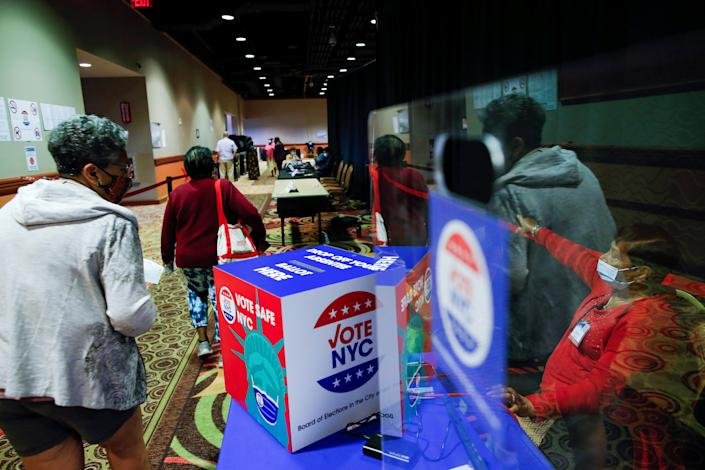 People arrive to the voting center on the first day of early voting for the New York Primary election at Resorts World Casino in Queens, New York City, U.S., June 12, 2021. (Eduardo Munoz/Reuters)