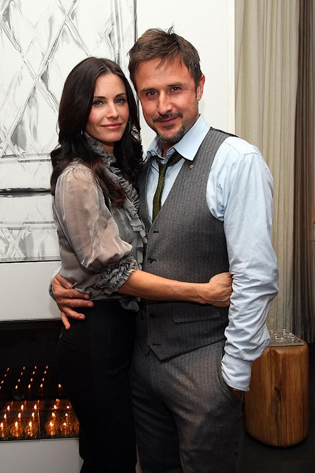 """Courteney Cox Arquette and her husband David get """"friendly."""" Jason Kempin/<a href=""""http://www.wireimage.com"""" target=""""new"""">WireImage.com</a> - January 22, 2009"""