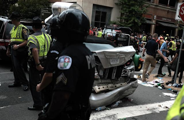"<p>First responders stand by a car that was struck when a car drove through a group of counter protesters at the ""Unite the Right"" rally Charlottesville, Va., Aug. 12, 2017. (Photo: Justin Ide/Reuters) </p>"