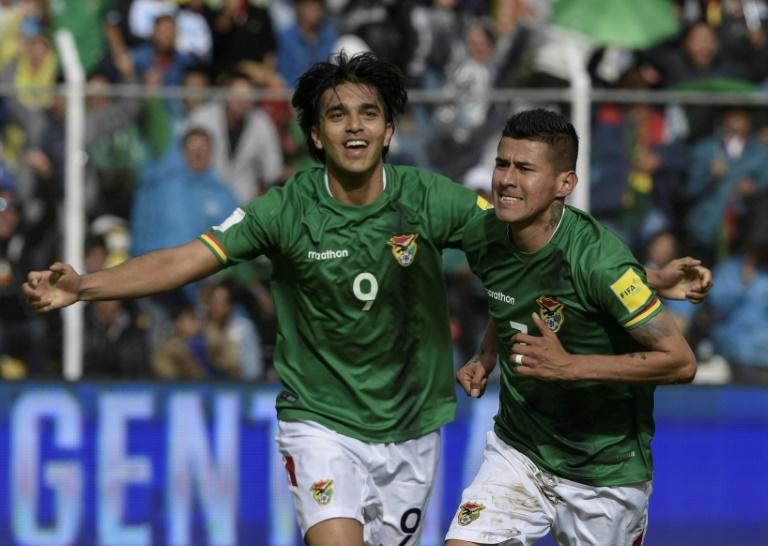 Bolivia's Juan Arce (R) celebrates with teammate Marcelo Martins after scoring a goal against Argentina during their Russia 2018 World Cup qualifier match, at Hernando Siles stadium in La Paz, on March 28, 2017