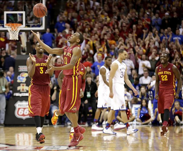 Iowa State players Monte Morris (11) and Melvin Ejim (3) celebrate after their upset over Kansas in an NCAA college basketball game in the semifinals of the Big 12 Conference tournament on Friday, March 14, 2014, in Kansas City, Mo. Iowa State won the game 94-83. (AP Photo/Charlie Riedel)