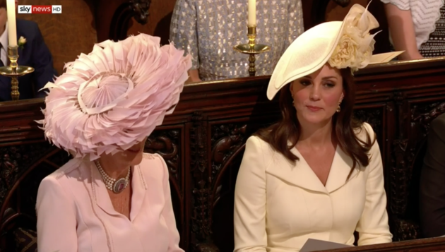 The Duchess of Cambridge (right) appears to suppress a little laugh while sitting next to the Duchess of Cornwall.