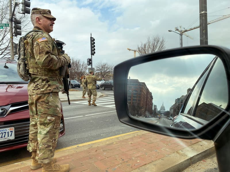 U.S. National Guard soldiers staff a checkpoint a few blocks from the Capitol in Washington