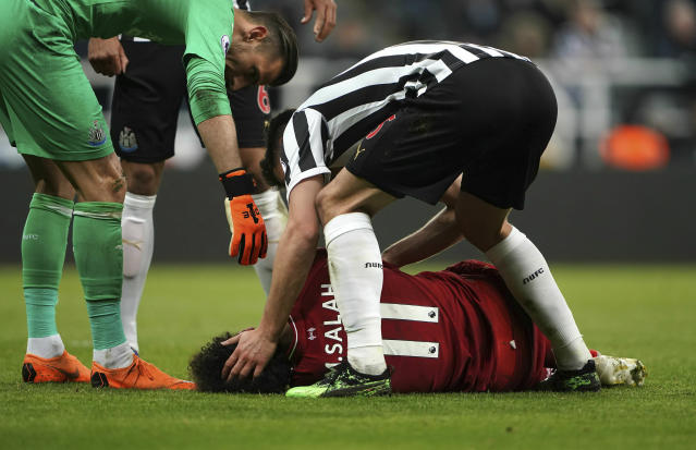 Liverpool's Mohamed Salah lies injured during a Premier League match against Newcastle United at St James' Park, Newcastle, England, Saturday May 4, 2019. (Owen Humphreys/PA via AP)