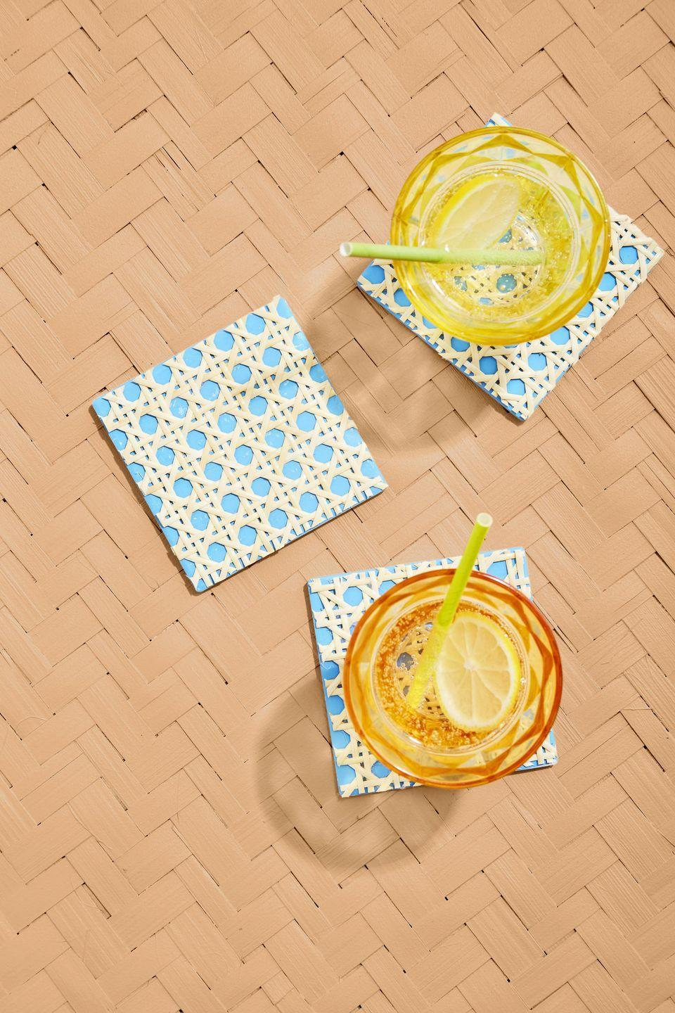 """<p>The base for these coaster can be painted any color so they'll fit right in to your already existing decor.<strong><br></strong><strong><br>To make:</strong> Paint unglazed ceramic coasters (<a href=""""https://www.amazon.com/Bisque-tiles-unpainted-use-underglazes/dp/B0019LS2VI/ref=sr_1_14"""" rel=""""nofollow noopener"""" target=""""_blank"""" data-ylk=""""slk:$14 for 10; amazon.com"""" class=""""link rapid-noclick-resp"""">$14 for 10;<em> amazon.com</em></a>) desired color. Cut pieces of caning that are just larger than the coasters. Spray the backs of the caning with adhesive spray, such as Super 77, then attach to the coasters, pressing to adhere. Trim excess caning with scissors.<br></p>"""