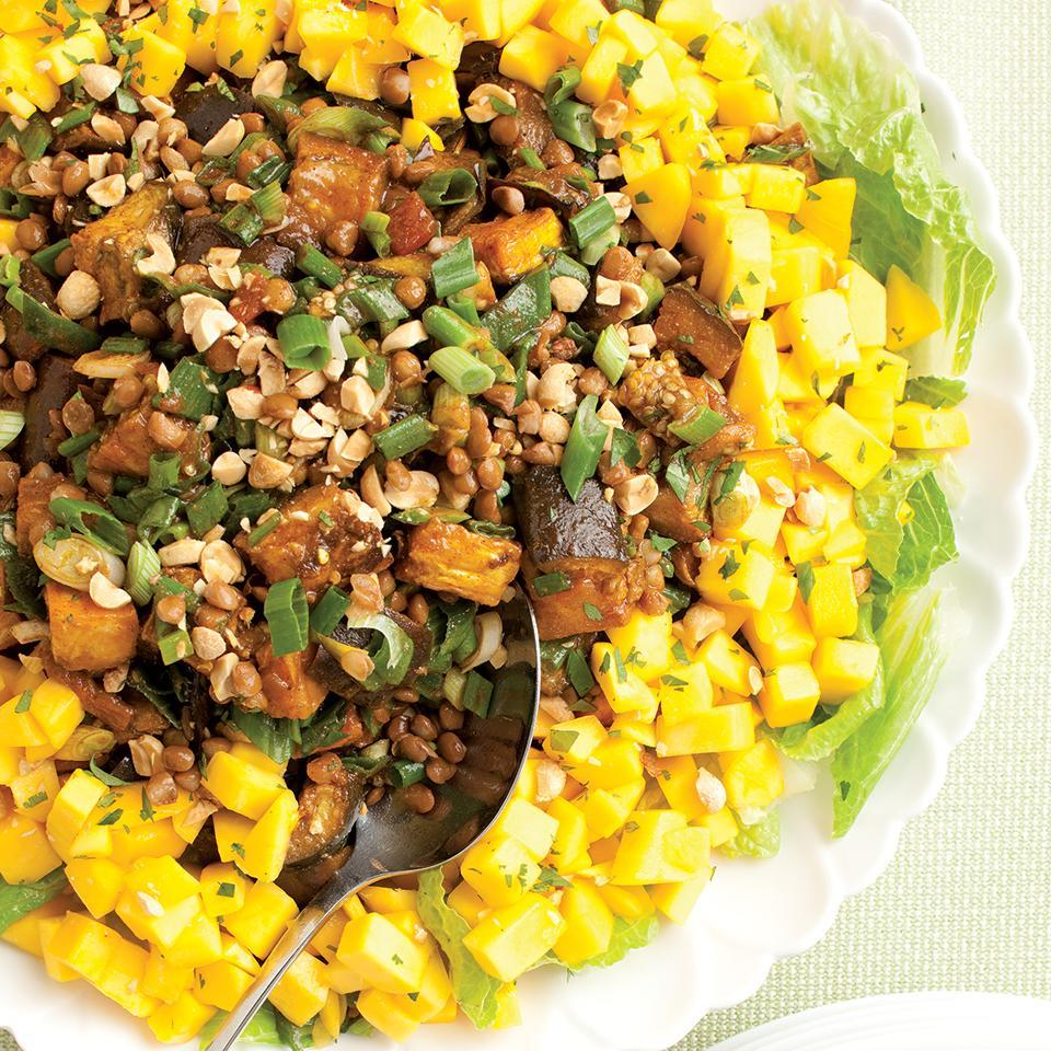 """<p>Spiced eggplant, lentils and mangoes combine deliciously in this Indian-inspired vegetarian salad. Customize the spiciness of this by choosing mild, medium or hot versions of salsa, chili powders and curry powder. The flavor is even better when the salad is prepared ahead. Recipe by Nancy Baggett for EatingWell. <a href=""""http://www.eatingwell.com/recipe/250062/spiced-eggplant-lentil-salad-with-mango/"""" rel=""""nofollow noopener"""" target=""""_blank"""" data-ylk=""""slk:View recipe"""" class=""""link rapid-noclick-resp""""> View recipe </a></p>"""