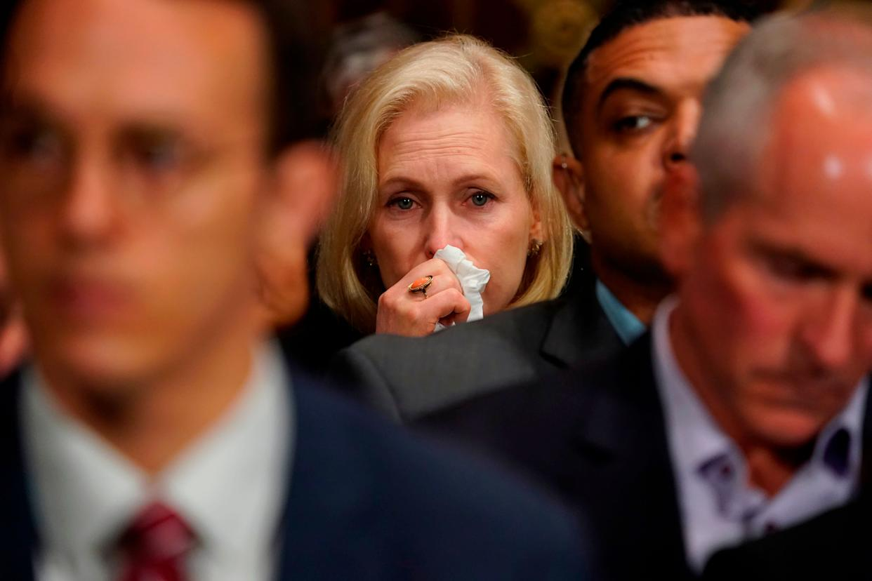 Sen. Kirsten Gillibrand, D-N.Y., cries as Christine Blasey Ford testifies.