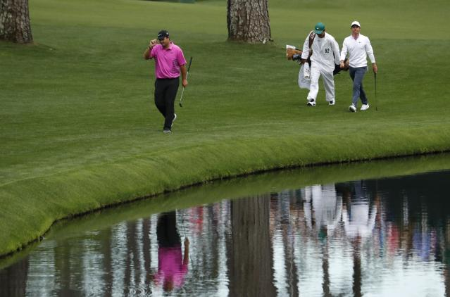 Patrick Reed of the U.S. (L) leads Rory McIlroy of Northern Ireland to the 16th green during final round play of the 2018 Masters golf tournament at the Augusta National Golf Club in Augusta, Georgia, U.S. April 8, 2018. REUTERS/Jonathan Ernst