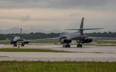 Two US Air Force B-1B Lancers prepare to take off from Andersen Air Force Base, Guam - Credit: AFP