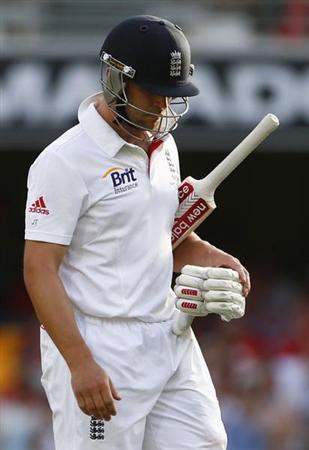 England's Jonathan Trott walks off the field after his dismissal by Australia's Mitchell Johnson during the third day's play of the first Ashes cricket test match in Brisbane November 23, 2013. REUTERS/David Gray