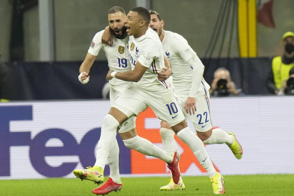 France's Karim Benzema, left, celebrates with teammate France's Kylian Mbappe after scoring during the UEFA Nations League final soccer match between France and Spain at the San Siro stadium, in Milan, Italy, Sunday, Oct. 10, 2021. (AP Photo/Luca Bruno)
