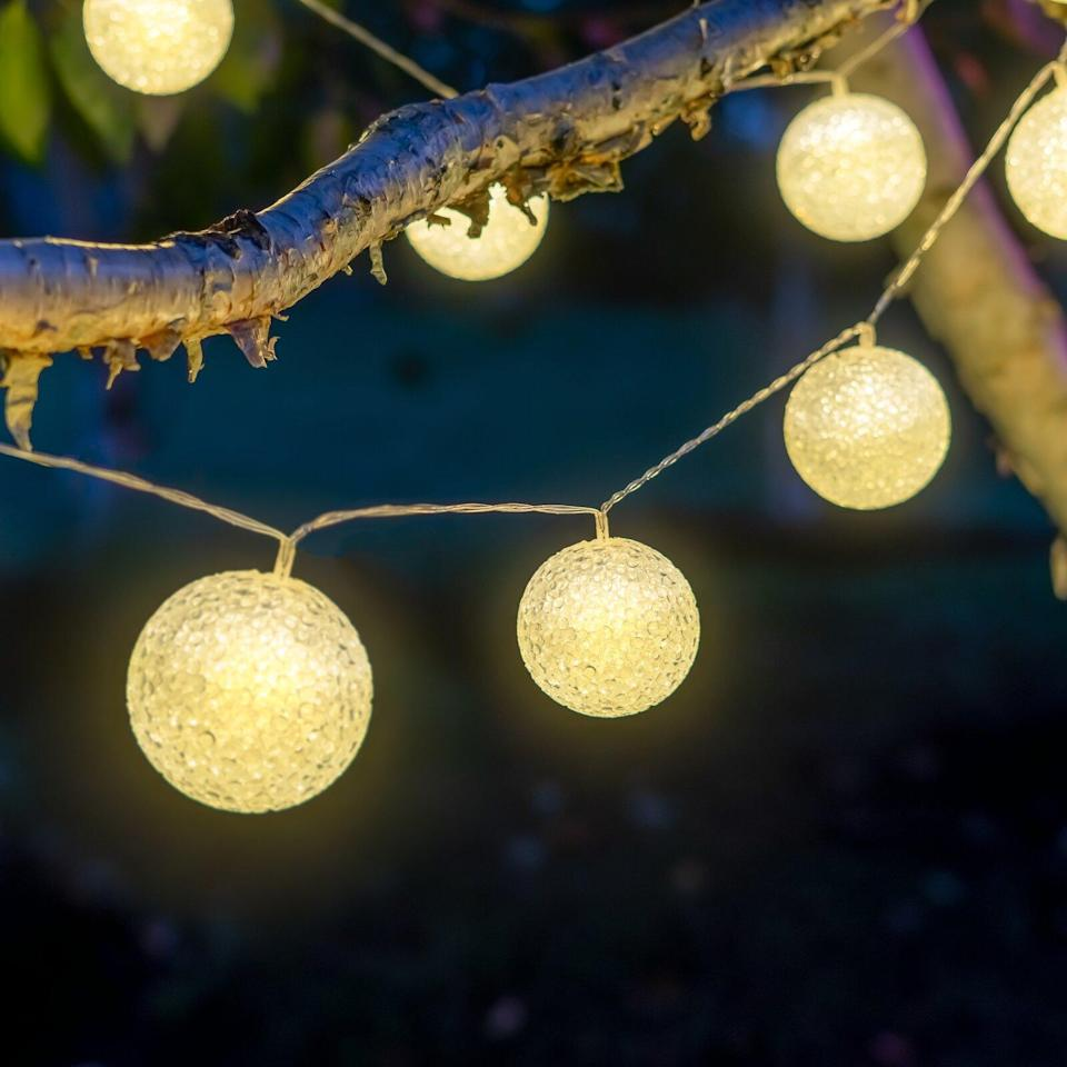 """<p>For a showy outdoor display, look for lights with snowball-style bulbs. This string features 10 ornament-inspired orbs that can be programmed in steady or flashing mode, depending on your mood.</p> <p><strong><em>Shop Now: </em></strong><em>Birch Lane """"Williamsburg"""" 20' Outdoor 10-Bulb Novelty String Light, $34, <a href=""""https://www.anrdoezrs.net/links/9104911/type/dlg/sid/MSLOurFavoriteChristmasLightstoBuyRightNowaharperChrGal8022885202011I/https://www.birchlane.com/home/pdp/williamsburg-20-outdoor-10-bulb-novelty-string-light-b000576015.html?piid="""" rel=""""nofollow noopener"""" target=""""_blank"""" data-ylk=""""slk:birchlane.com"""" class=""""link rapid-noclick-resp"""">birchlane.com</a></em><em>. </em></p>"""