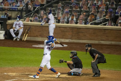 New York Mets' J.D. Davis (28) follows through on a three-run home run during the seventh inning of a baseball game against the Miami Marlins Saturday, Aug. 8, 2020, in New York. (AP Photo/Frank Franklin II)
