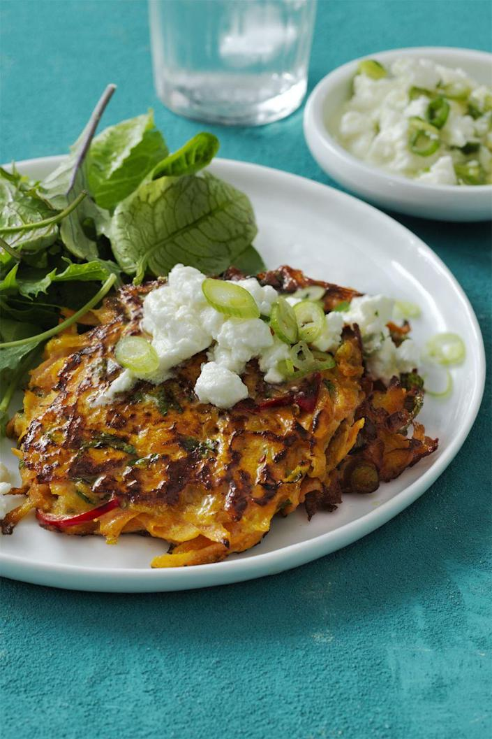 "<p>Potato pancakes are always a crowd favorite, and this carrot version is a super-fun and lighter twist for a side that'll go with anything. Or eat them on their own! </p><p><em><a href=""https://www.womansday.com/food-recipes/food-drinks/recipes/a58145/spiced-carrot-fritters-recipe/"" rel=""nofollow noopener"" target=""_blank"" data-ylk=""slk:Get the Spiced Carrot Fritters recipe."" class=""link rapid-noclick-resp"">Get the Spiced Carrot Fritters recipe.</a></em></p>"