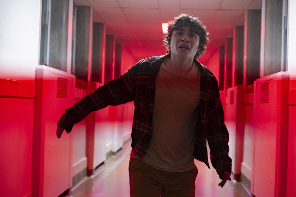 Austin Zajur flees one of the many creatures in André Øvredal horror film 'Scary Stories to Tell in the Dark'. (Credit: eOne)