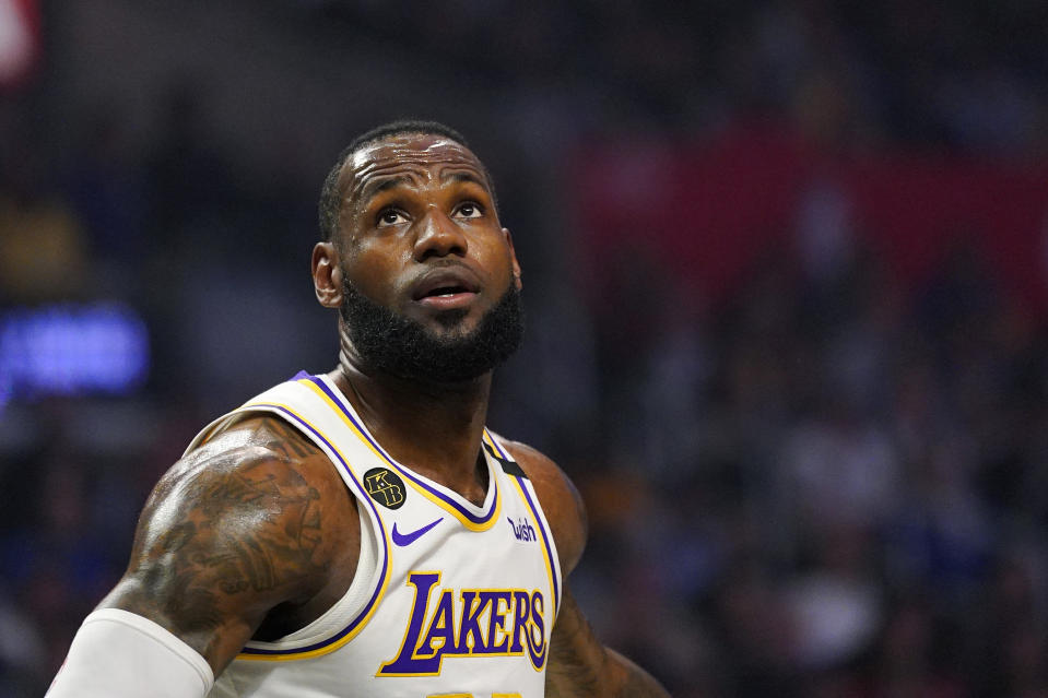 Los Angeles Lakers forward LeBron James watches for a rebound during the first half of an NBA basketball game against the Los Angeles Clippers Sunday, March 8, 2020, in Los Angeles. (AP Photo/Mark J. Terrill)