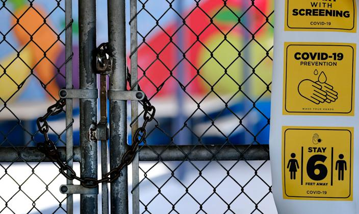 In this July 13, 2020, file photo, a gate is locked at the closed Ranchito Elementary School in the San Fernando Valley section of Los Angeles.